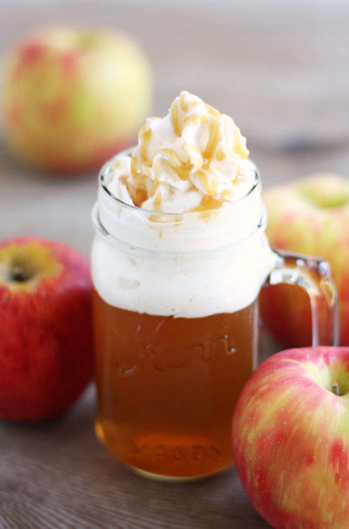 Caramel Apple Cider with Whipped Cream in Mason Jar