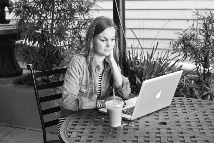 Ciera Holzenthal with MacBook Pro at Coffee Shop Courtyard