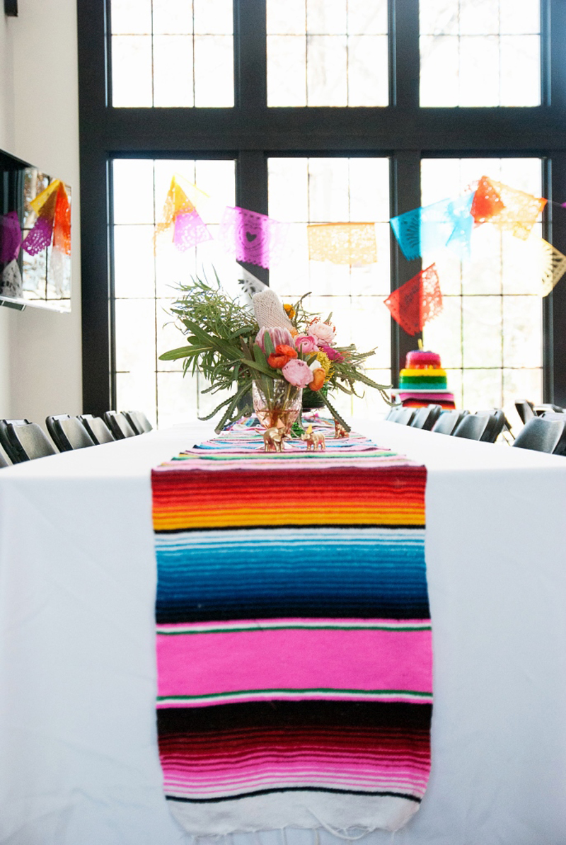table setting with blanket and  papel picado garland