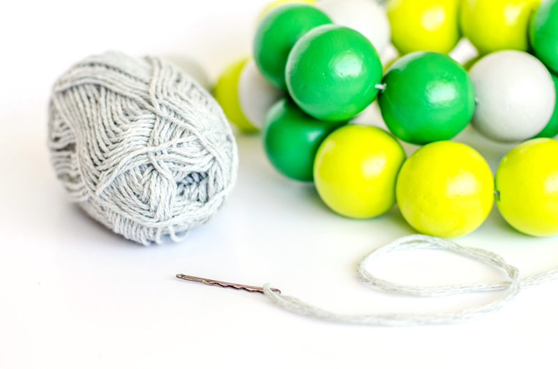 styrofoam balls and yarn for secret message garland