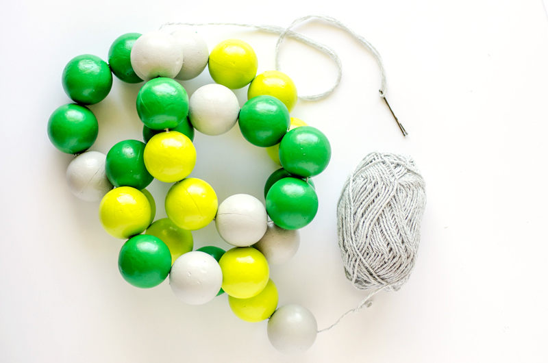 threading styrofoam balls for secret message garland